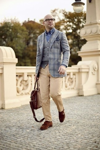 How to Wear a Grey Sweater Vest For Men: This elegant combination of a grey sweater vest and khaki dress pants is undoubtedly a statement-maker. Balance this look with a more laid-back kind of footwear, such as these brown suede double monks.