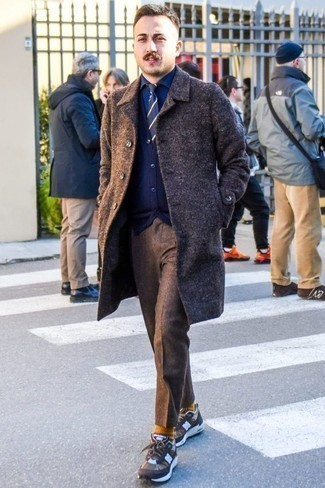 Men's Looks & Outfits: What To Wear In Cold Weather: Wear a dark brown overcoat and brown wool chinos if you're going for a crisp, seriously stylish ensemble. Have some fun with things and add brown athletic shoes to the mix.
