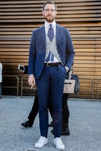 How to Wear a White Dress Shirt For Men: Teaming a white dress shirt and a navy suit will be a good manifestation of your outfit coordination chops. Upgrade your ensemble with a pair of white canvas low top sneakers.