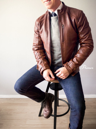 How to wear: navy jeans, white dress shirt, grey sweatshirt, brown leather bomber jacket