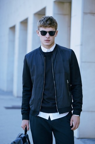 How to Wear a Navy Bomber Jacket For Men: Consider teaming a navy bomber jacket with navy sweatpants for a casually cool and stylish ensemble.