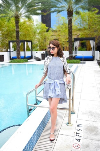 How to wear: silver leather flat sandals, light blue dress shirt, grey swing dress, white and black print windbreaker