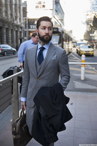 How to wear: dark brown leather briefcase, light blue check dress shirt, grey three piece suit, black overcoat