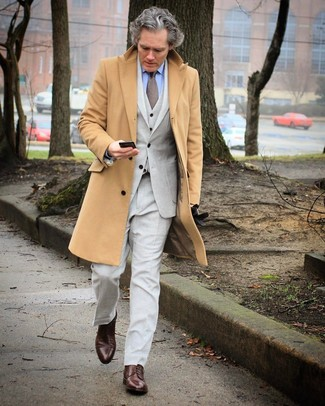 How to wear: dark brown leather derby shoes, light blue dress shirt, grey three piece suit, camel overcoat
