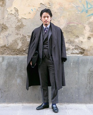 How to wear: black leather loafers, light blue dress shirt, charcoal three piece suit, charcoal herringbone overcoat