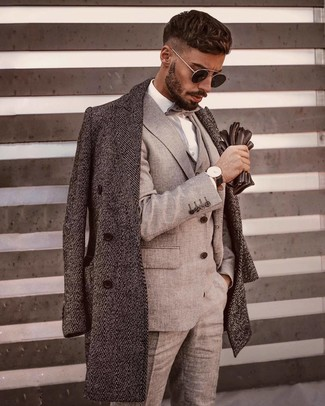 How to wear: grey bow-tie, white dress shirt, grey three piece suit, grey herringbone overcoat