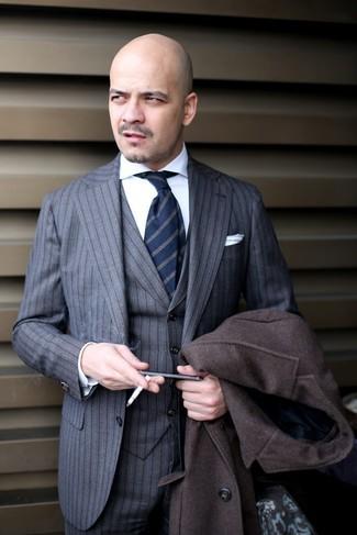 How to wear: navy vertical striped tie, white dress shirt, grey vertical striped three piece suit, dark brown overcoat