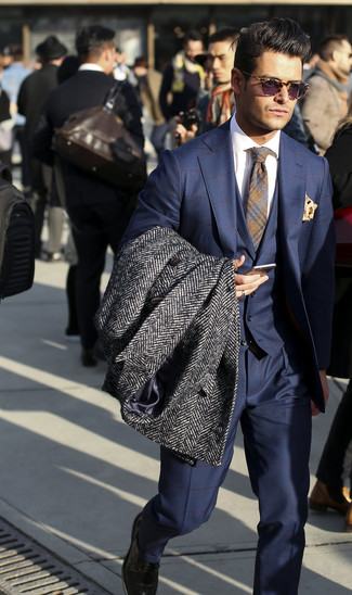 How to Wear a Charcoal Herringbone Overcoat: When it comes to timeless classic style, this combination of a charcoal herringbone overcoat and a navy check three piece suit doesn't disappoint.