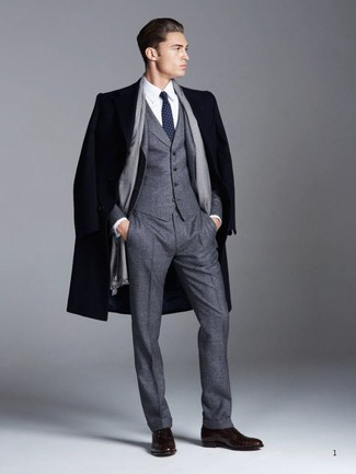 How to wear: dark brown leather oxford shoes, white dress shirt, charcoal wool three piece suit, navy overcoat