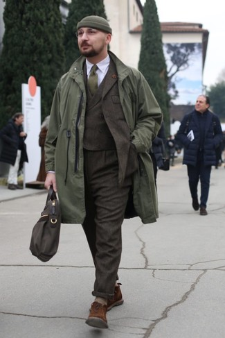 How to wear: brown suede desert boots, white dress shirt, dark brown wool three piece suit, olive raincoat
