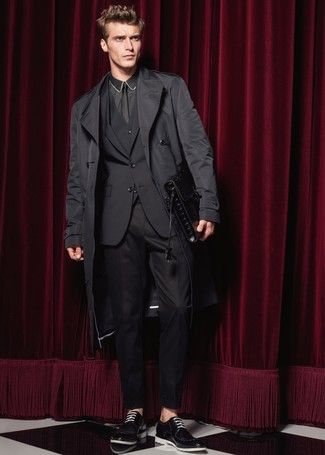 How to wear: black leather derby shoes, black dress shirt, black three piece suit, black trenchcoat
