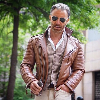 How to wear: beige jeans, white dress shirt, brown plaid waistcoat, brown leather biker jacket