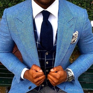 How to Wear a Navy Check Waistcoat In a Dressy Way: Putting together a navy check waistcoat and charcoal dress pants is a fail-safe way to breathe class into your current wardrobe.