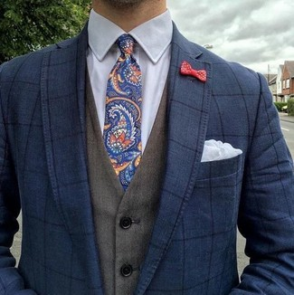 How to wear: navy paisley tie, white dress shirt, olive waistcoat, navy check blazer