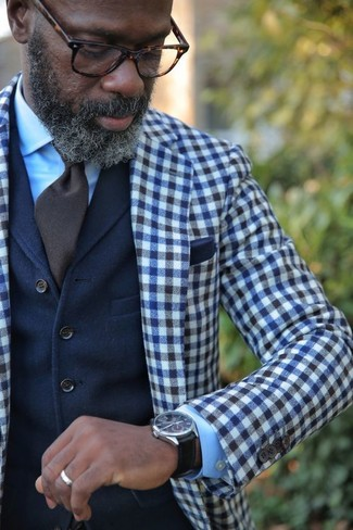 How to wear: dark brown tie, light blue dress shirt, navy wool waistcoat, navy and white gingham wool blazer
