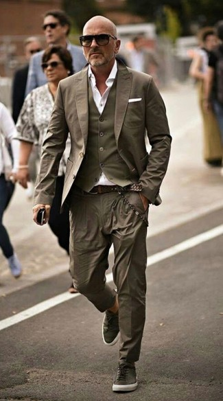 How to wear: olive chinos, white dress shirt, olive waistcoat, olive blazer
