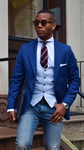 How to Wear a Light Blue Waistcoat: Marrying a light blue waistcoat with blue ripped skinny jeans is an on-point idea for a casual and cool outfit.