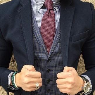 How to wear: burgundy print tie, white and navy gingham dress shirt, navy plaid waistcoat, black blazer