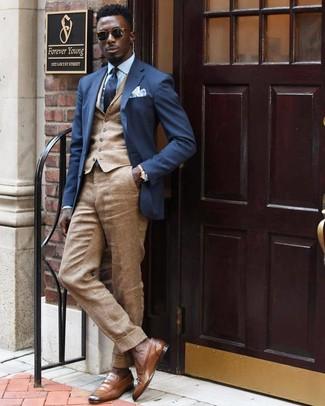 How to wear: khaki linen dress pants, light blue dress shirt, tan waistcoat, navy blazer