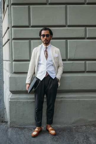 How to Wear a Beige Vertical Striped Blazer For Men: Demonstrate that nobody does casual quite like you do by opting for a beige vertical striped blazer and black vertical striped chinos. If you wish to instantly elevate this ensemble with shoes, why not complete your ensemble with tan leather loafers?