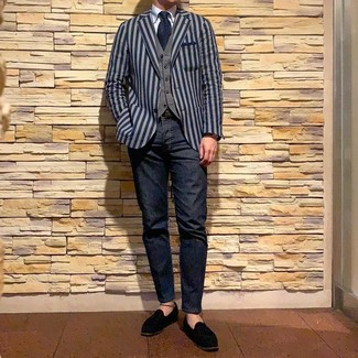 How to wear: navy jeans, light blue dress shirt, grey waistcoat, navy vertical striped blazer