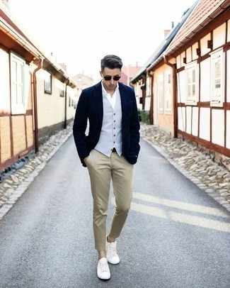 How to Wear a Light Blue Waistcoat: Team a light blue waistcoat with khaki chinos for extra dapper style. Feeling brave today? Switch things up with white canvas low top sneakers.