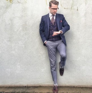 How To Wear a Waistcoat With Tassel Loafers: A waistcoat and light blue chinos matched together are a sartorial dream for those who appreciate effortlessly refined styles. A pair of tassel loafers is a great idea to complement your ensemble.
