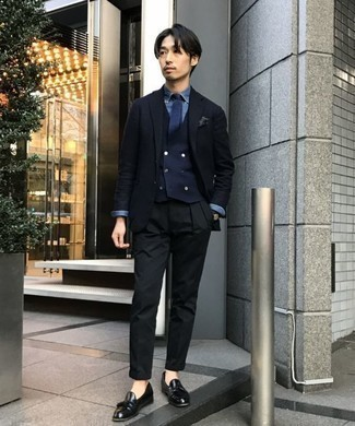 How to Wear a Navy Waistcoat: Teaming a navy waistcoat and black chinos is a fail-safe way to inject style into your wardrobe. Throw in black leather tassel loafers et voila, your outfit is complete.
