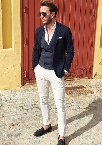 How to Wear a Navy Waistcoat: Pair a navy waistcoat with white chinos if you're going for a neat, fashionable ensemble. Add navy suede tassel loafers to your outfit and ta-da: the getup is complete.