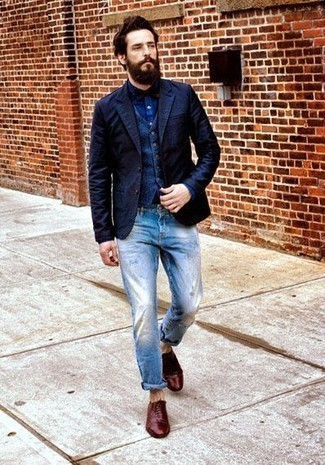 How to Wear a Navy Waistcoat: This ensemble demonstrates it is totally worth investing in such menswear must-haves as a navy waistcoat and light blue ripped jeans. Finishing with a pair of burgundy leather oxford shoes is an easy way to infuse a sense of refinement into your outfit.