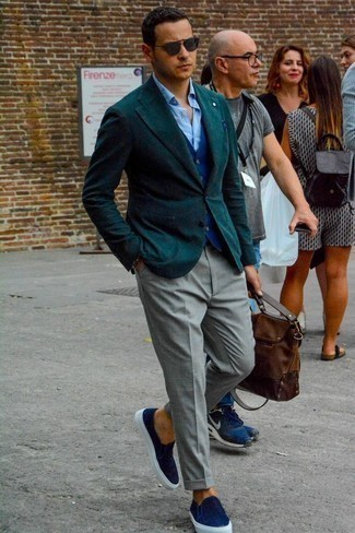 How to Wear a Brown Leather Briefcase: Wear a dark green blazer with a brown leather briefcase for a relaxed take on casual urban combinations. Don't know how to round off this outfit? Rock a pair of navy canvas slip-on sneakers to elevate it.