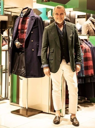 How to Wear a Coat For Men: Swing into something classy yet on-trend in a coat and beige jeans. Tap into some David Gandy dapperness and polish up your getup with a pair of brown leather loafers.