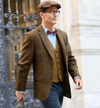 How to wear: charcoal jeans, light blue dress shirt, tan wool waistcoat, brown check wool blazer