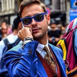 How to wear: olive paisley tie, white dress shirt, red print waistcoat, blue vertical striped blazer