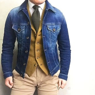 How to wear: khaki cargo pants, white dress shirt, mustard wool waistcoat, blue denim jacket