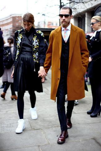 How to wear: navy vertical striped dress pants, white dress shirt, navy vertical striped waistcoat, mustard overcoat