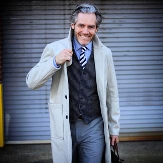 How to wear: grey dress pants, light blue dress shirt, navy vertical striped waistcoat, grey overcoat