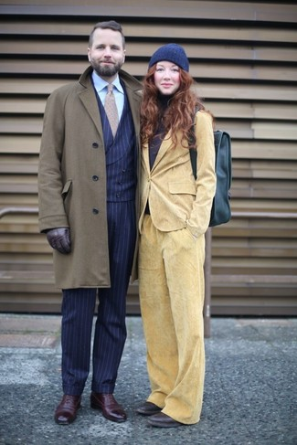 How to wear: navy vertical striped dress pants, light blue dress shirt, navy vertical striped waistcoat, olive overcoat