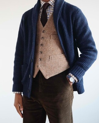 How to wear: dark brown corduroy jeans, white check dress shirt, tan wool waistcoat, navy shawl cardigan
