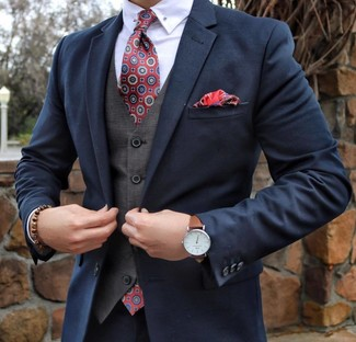 How to wear: red print tie, white dress shirt, grey waistcoat, navy suit