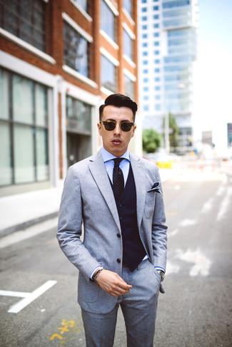 How to wear: black polka dot tie, light blue dress shirt, navy vertical striped waistcoat, grey wool suit
