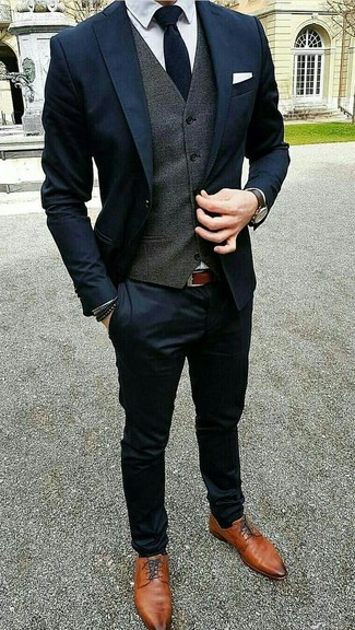 How to wear: tobacco leather derby shoes, white dress shirt, charcoal waistcoat, navy suit