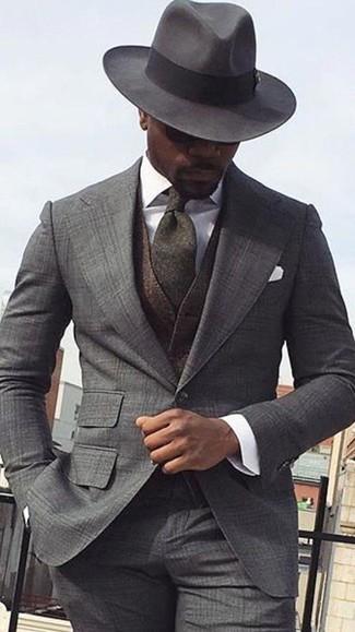How to wear: charcoal wool hat, white dress shirt, dark brown wool waistcoat, grey plaid suit