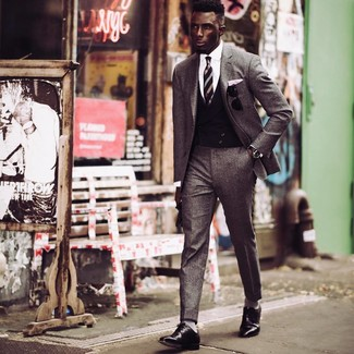 How to wear: black leather derby shoes, white dress shirt, black waistcoat, grey wool suit