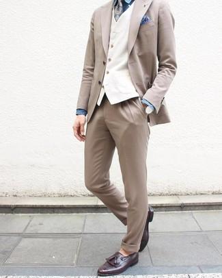 How to wear: dark purple leather tassel loafers, blue chambray dress shirt, white waistcoat, beige suit