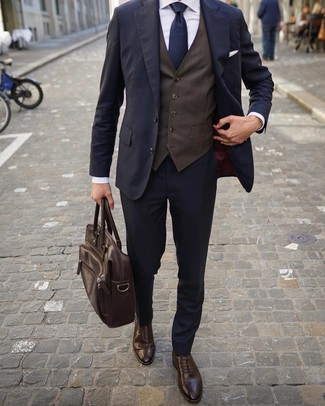How to wear: dark brown leather brogues, white dress shirt, dark brown waistcoat, navy suit