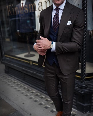 How to wear: brown leather oxford shoes, white dress shirt, navy waistcoat, dark brown suit