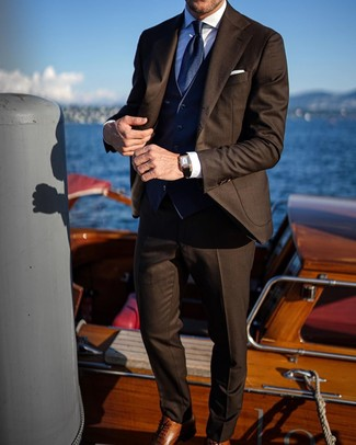 How to Wear a Dark Brown Suit In a Dressy Way: You're looking at the hard proof that a dark brown suit and a navy waistcoat look awesome when married together in a classy outfit for a modern gent. Finishing with brown leather oxford shoes is a guaranteed way to infuse a more laid-back twist into this look.