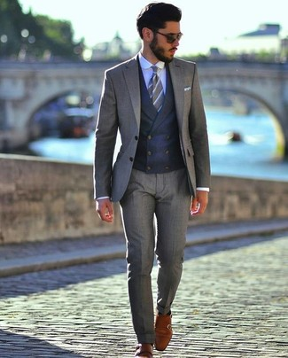 How to wear: tobacco leather double monks, light blue dress shirt, navy waistcoat, grey suit