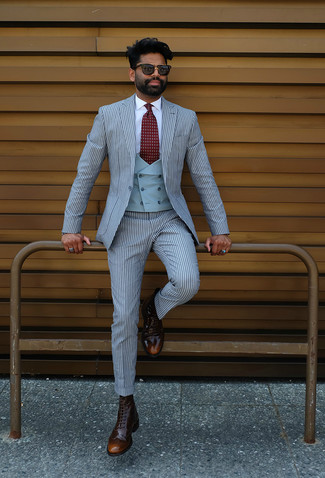 How to wear: dark brown leather brogue boots, white dress shirt, light blue waistcoat, light blue vertical striped suit